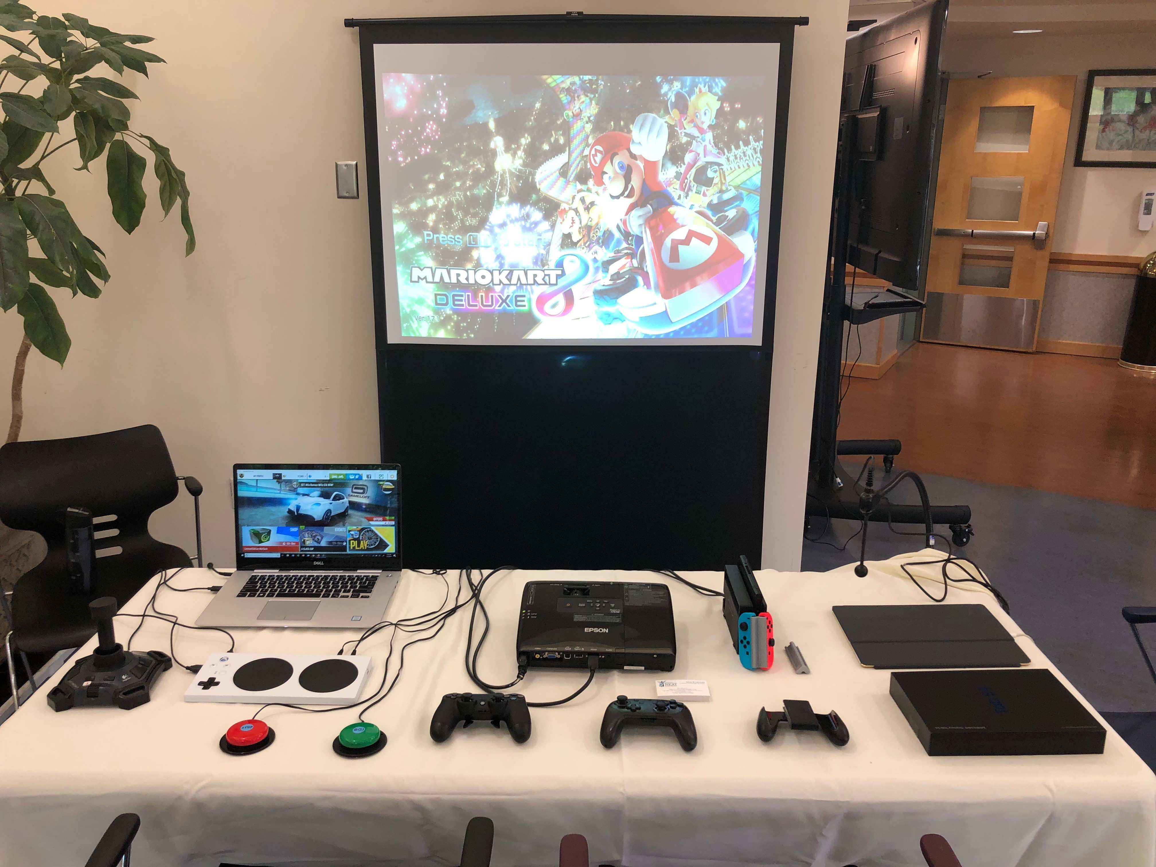 Gaming accessibility station with a variety of games, consoles, and accessories so everyone can play!